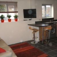 Wall mounted flat screen TV in accommodation lounge area of 74 Grace Dieu Road Loughborough.