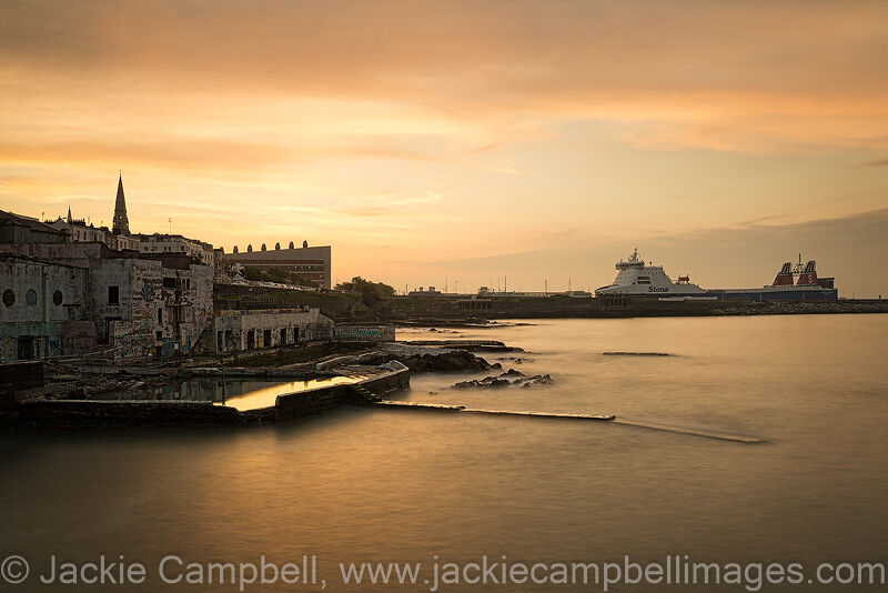 Dun Laoghaire Baths at sunset with the Sealink Ferry in the background