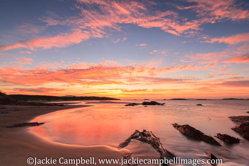 Sunset, rocky bay