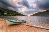 Boat on the lake shore at sunrise
