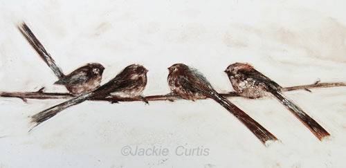 A line of Long Tailed Tits