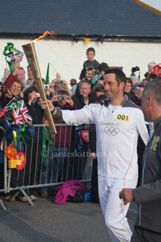 Ben Ainslie carrying the Olympic Flame at Land's End