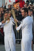 Ben Ainslie with the Olympic Flame at Land's End