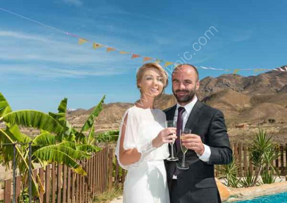 Bride and Groom enjoying a glass of Champagne