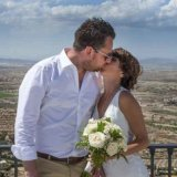 Bride and Groom kissing in the sunshine in Spain