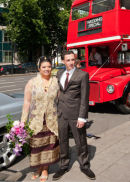 Outside with wedding special London Bus