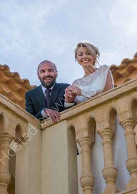 Bride and Groom on the Balcony