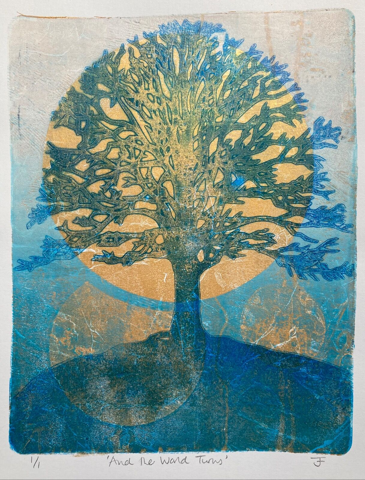Monotype print of a silhouetted mature tree against a rising golden sun and a turquoise sky. Seventies British Folk Horror feel.