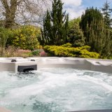 image of hot tub & view up through garden