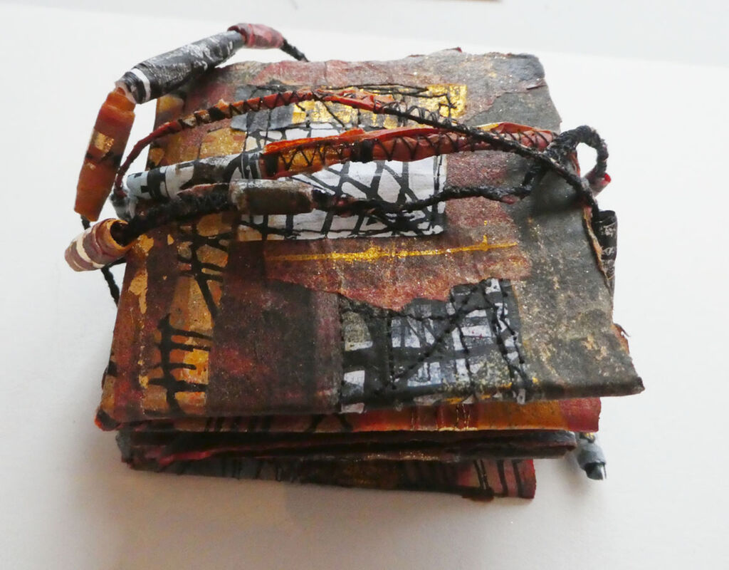 Threads: Explosion, Monotype, Lino, Collage and Free Motion Stitch. A folded book inspired by the Bradford Textile Archive and created in response to the Inkers Printmakers 'Inkerwoven' project.
