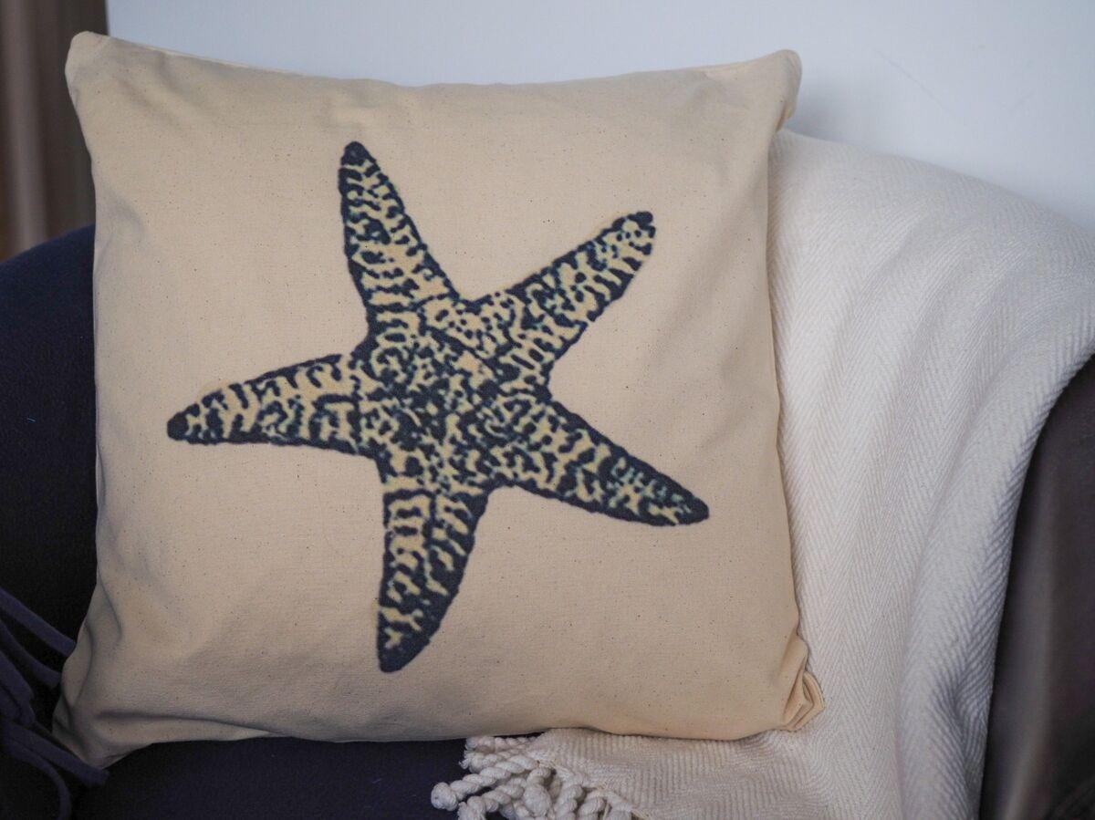 Cotton canvas coastal cushion with blue starfish