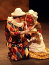 Smeraldina and Arlecchino read a letter from Clarice to Beatrice.