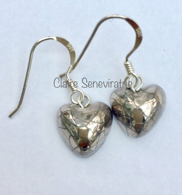 Heart earrings with silver lustre.