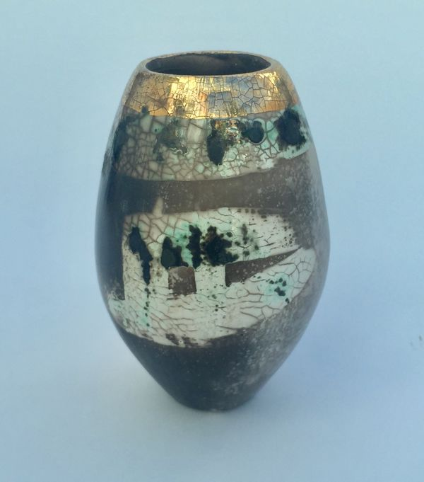 Upright smoke-fired ceramic pot with gold lustre.