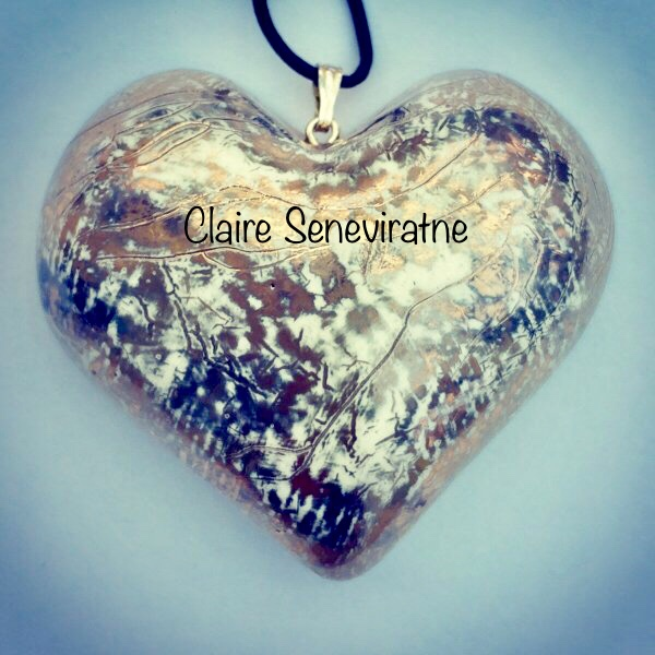 Large Gold and platinum heart pendant.