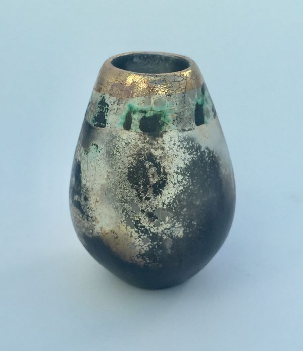Small upright smoke-fired ceramic pot.