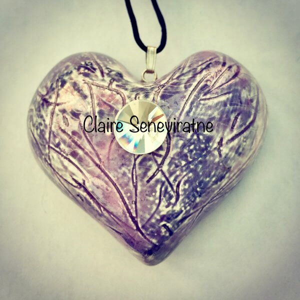 Large purple heart pendant.