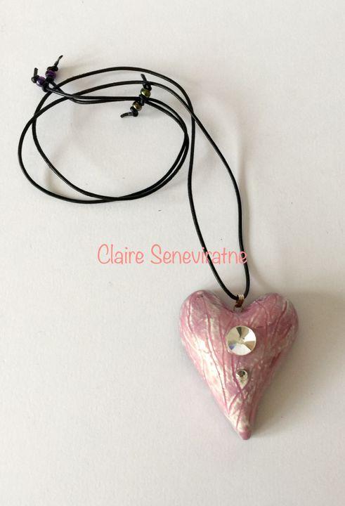 Large pink ceramic heart pendant.