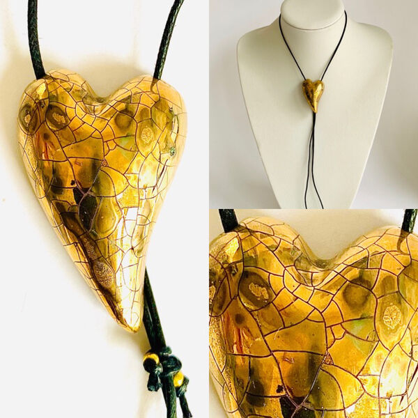 Gold heart porcelain pendant with copper markings.