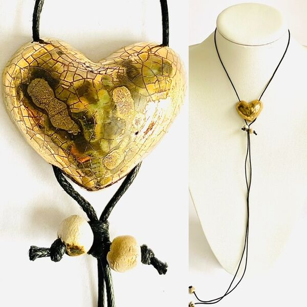 Gold heart with gold lustre and copper markings.