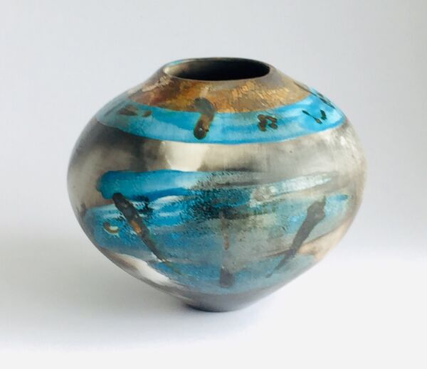 Blue burnished smoke-fired ceramic pot with gold lustre.
