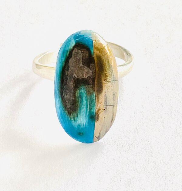 Blue porcelain ring on a sterling silver adjustable band.