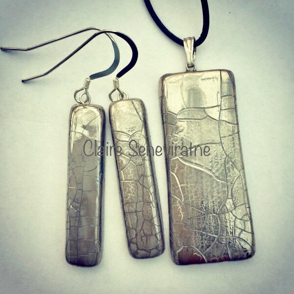 Rectangular silver lustre crackled  pendant with long earrings.