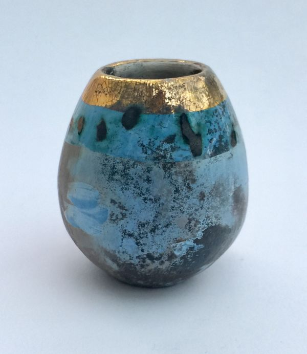 Small blue smoke-fired pot with gold lustre.