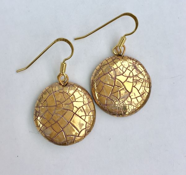 Round ceramic earrings with glaze and gold lustre.