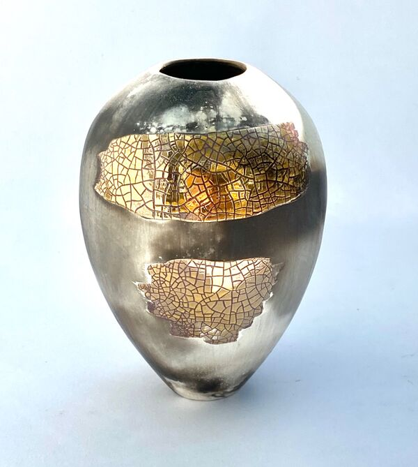 Small upright gold lustre smoke-fired porcelain pot.