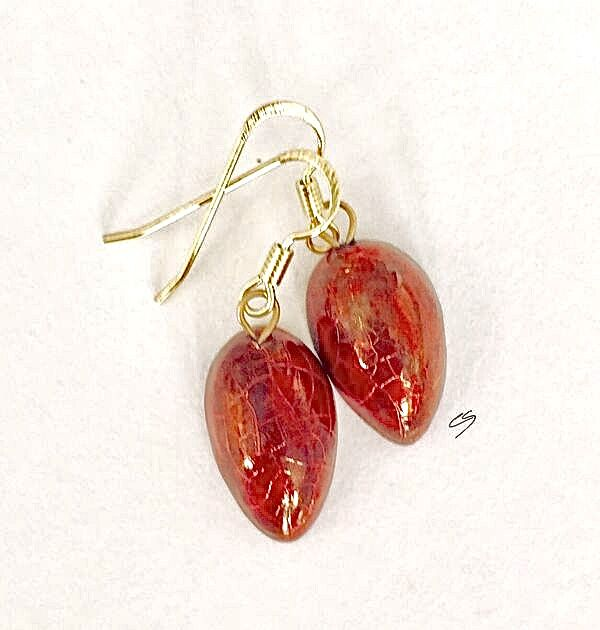 Red teardrop ceramic earrings with crackle glaze.