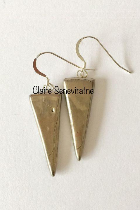 Silver porcelain triangle earrings.