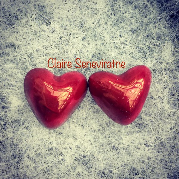 Red lustre heart earrings.