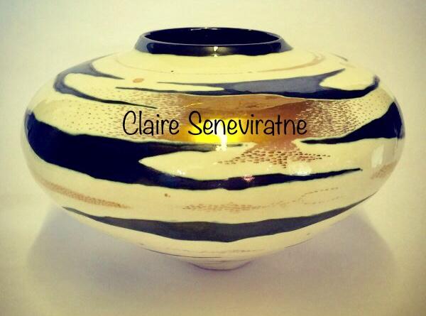 Ceramic pot with gold lustre.