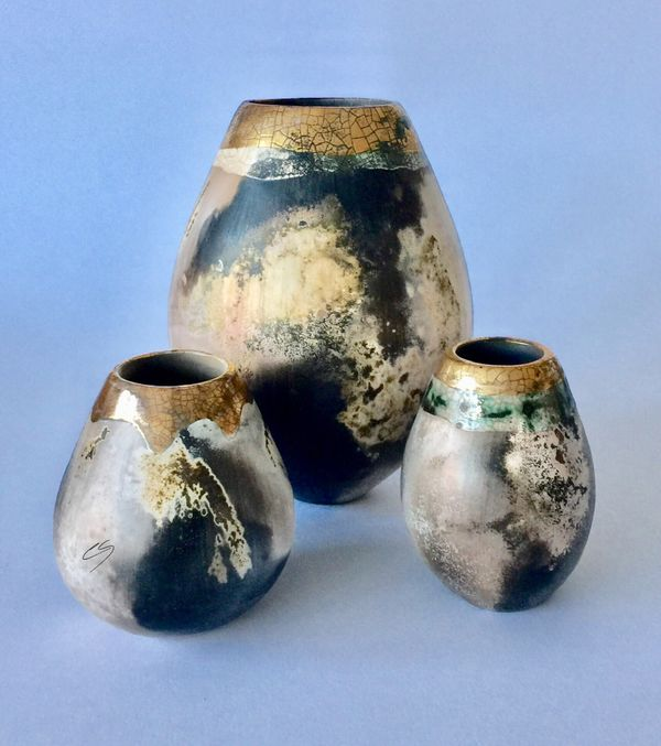 Group of 3 smoke fired pots.