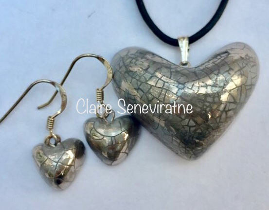 Silver heart jewellery set.