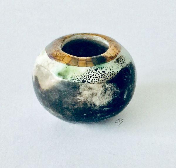 Tiny smoke fired pot.