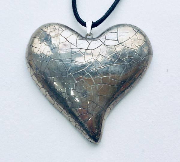 Large flat silver ceramic heart.