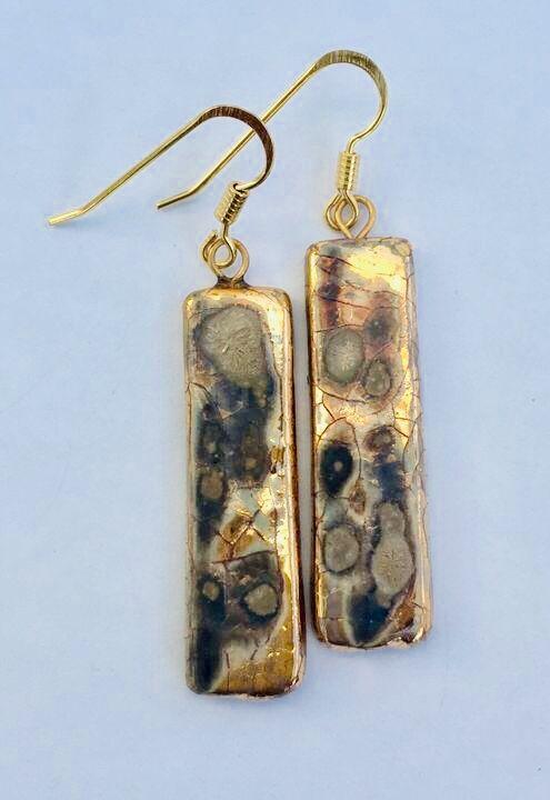 Gold rectangular drop earrings.