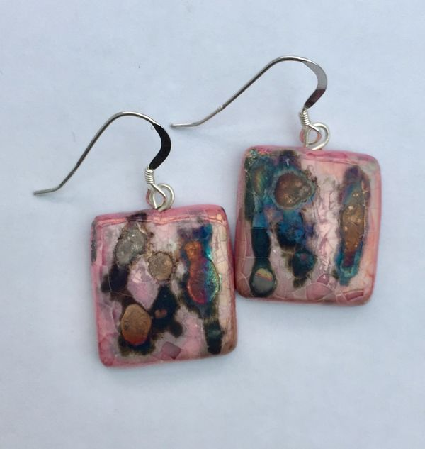 Pink square ceramic earrings with iridescent colours.