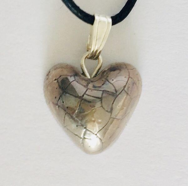 Small silver heart pendant.