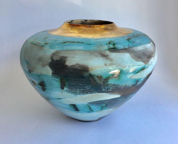 Large blue smoke-fired pot.