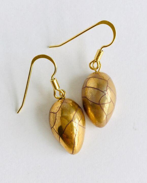 Gold teardrop earrings.