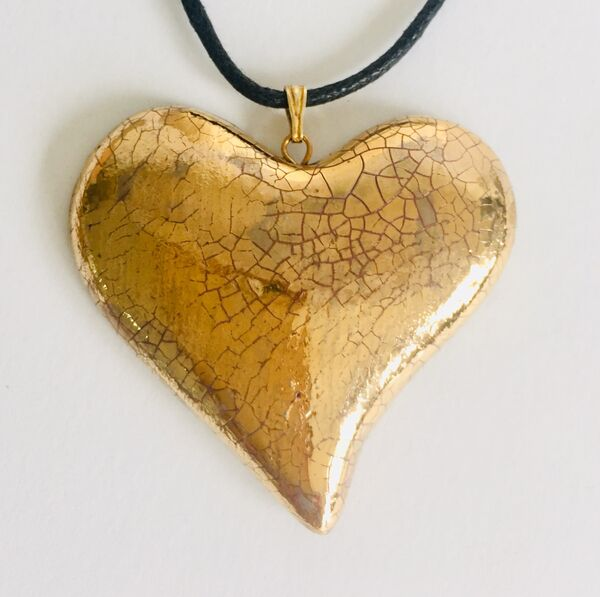 Gold heart pendant.