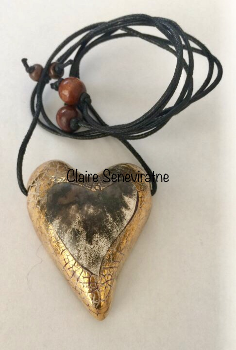 Smoke fired heart pendant.