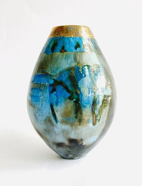 Blue pit-fired ceramic vessel.