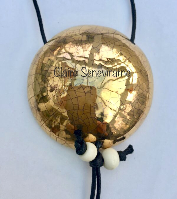 Large round gold pendant.