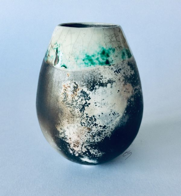 Smoke fired pot with copper carbonate.