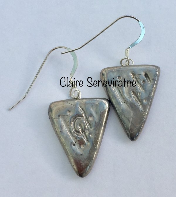 Silver triangle earrings.