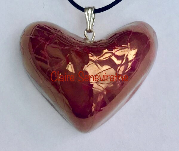 Red heart pendant.